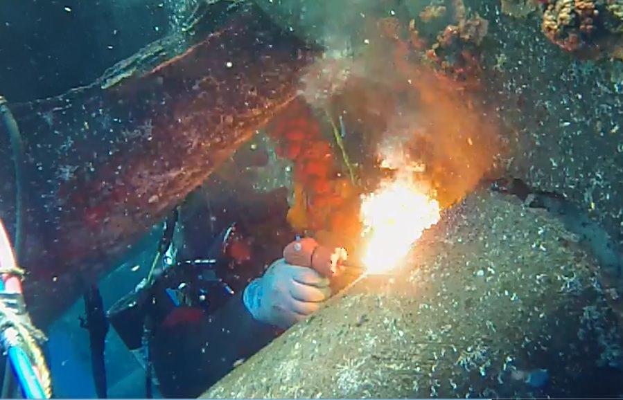 Brian Greene burning underwater